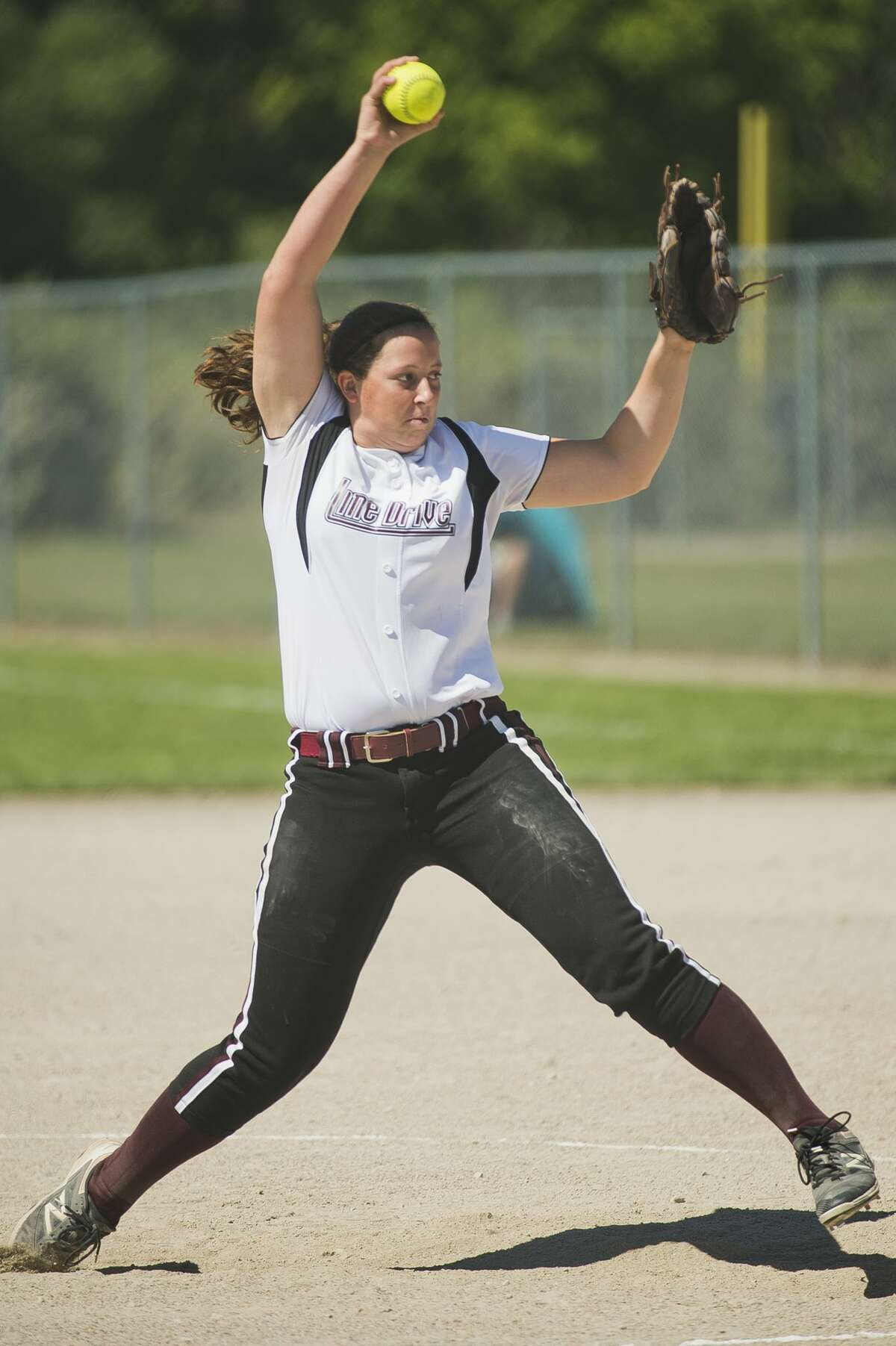 Midland Line Drive Express's Carrie Chamberlain delivers a pitch during a July 8, 2017 game against Midland Lady Explorers.