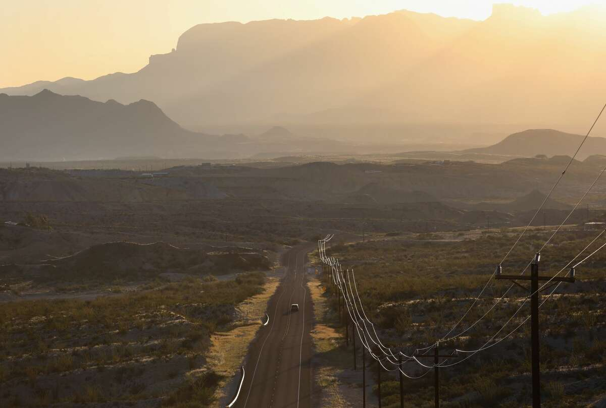 A car rides down open road after sunrise in the Big Bend region of west Texas near Terlingua, Texas. Texas was ranked second for best state for road trips, according to Wallethub.