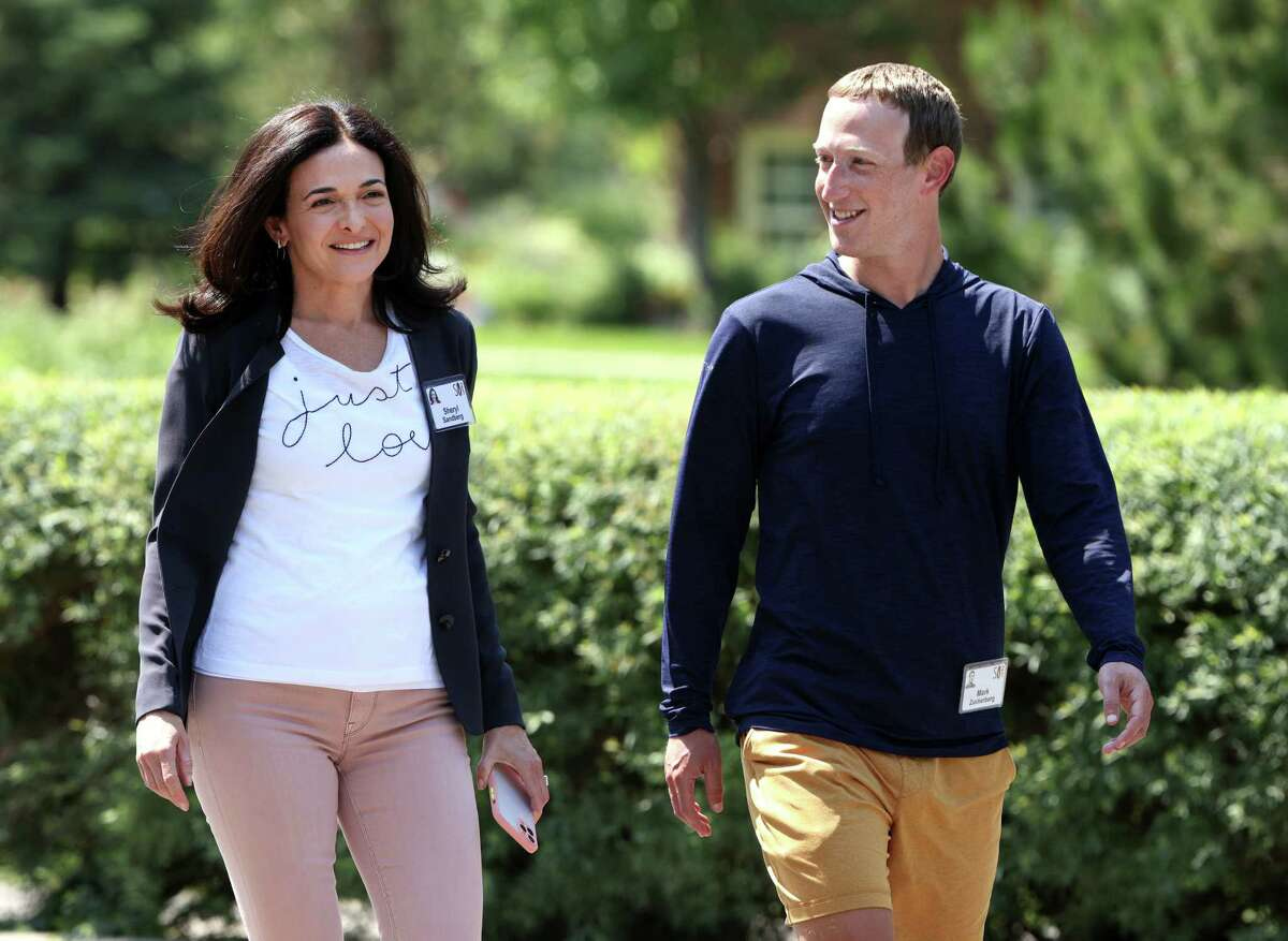 SUN VALLEY, IDAHO - JULY 09: CEO of Facebook Mark Zuckerberg walks with COO of Facebook Sheryl Sandberg after a session at the Allen & Company Sun Valley Conference on July 08, 2021 in Sun Valley, Idaho. After a year hiatus due to the COVID-19 pandemic, the world's most wealthy and powerful businesspeople from the media, finance, and technology worlds will converge at the Sun Valley Resort for the exclusive week-long conference.