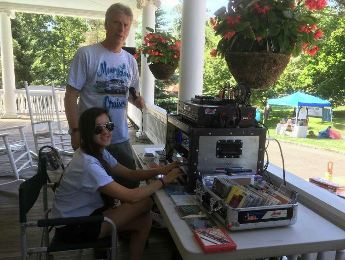 Sarah Leavy and her father Steve, a past club president, man the DJ booth at Memory Lane Cruisers' annual car show at Lounsbury House. Steve's love of classic rock heavily influenced Leavy to keep up the hobby despite her diagnosis.