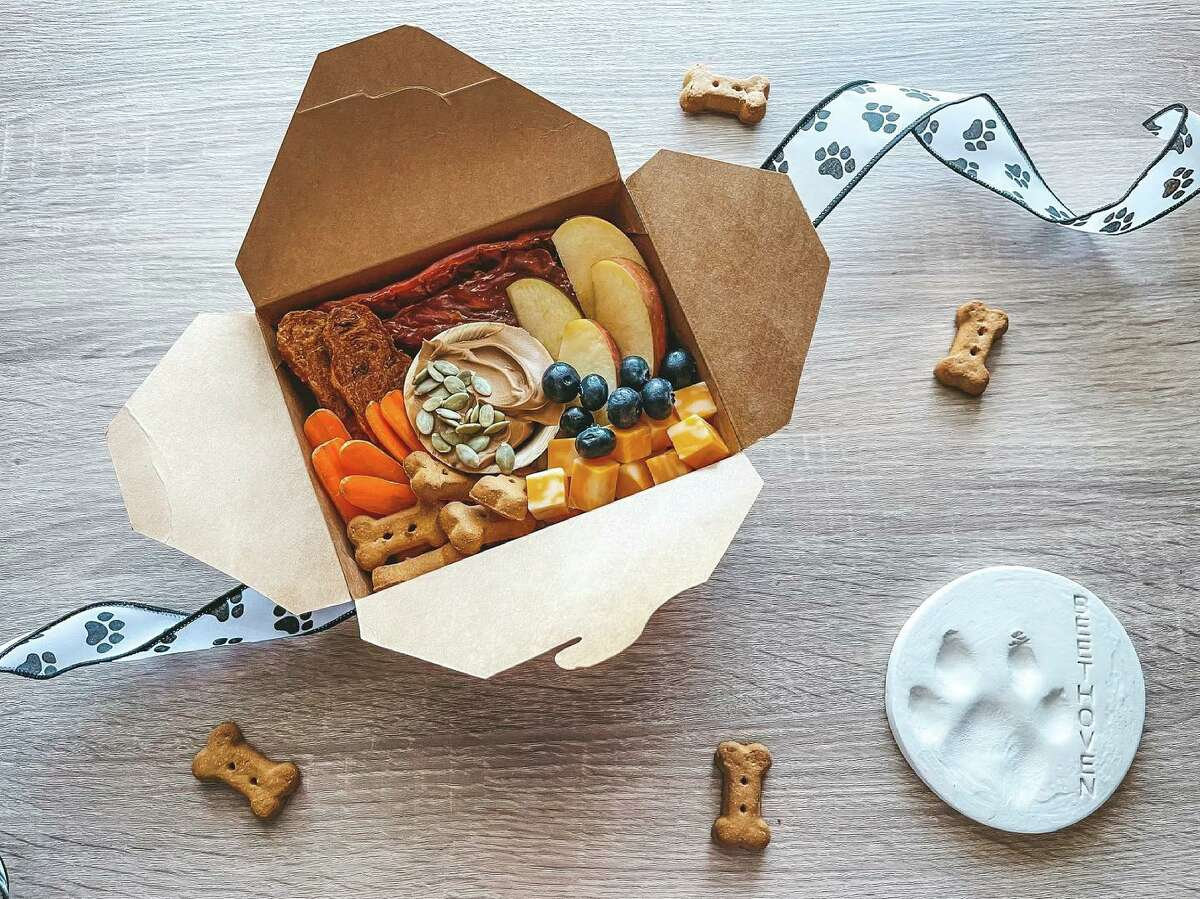 """Abigail Medlin, owner of AbBees Charcuterie Boards, offers options ranging from spreads for parties to handheld """"charcuties."""" Her latest creation, Bubba Boxes, are for the dogs. The meat and cheese packages give fido a touch of foofoo, but they also come with a sentimental purpose."""