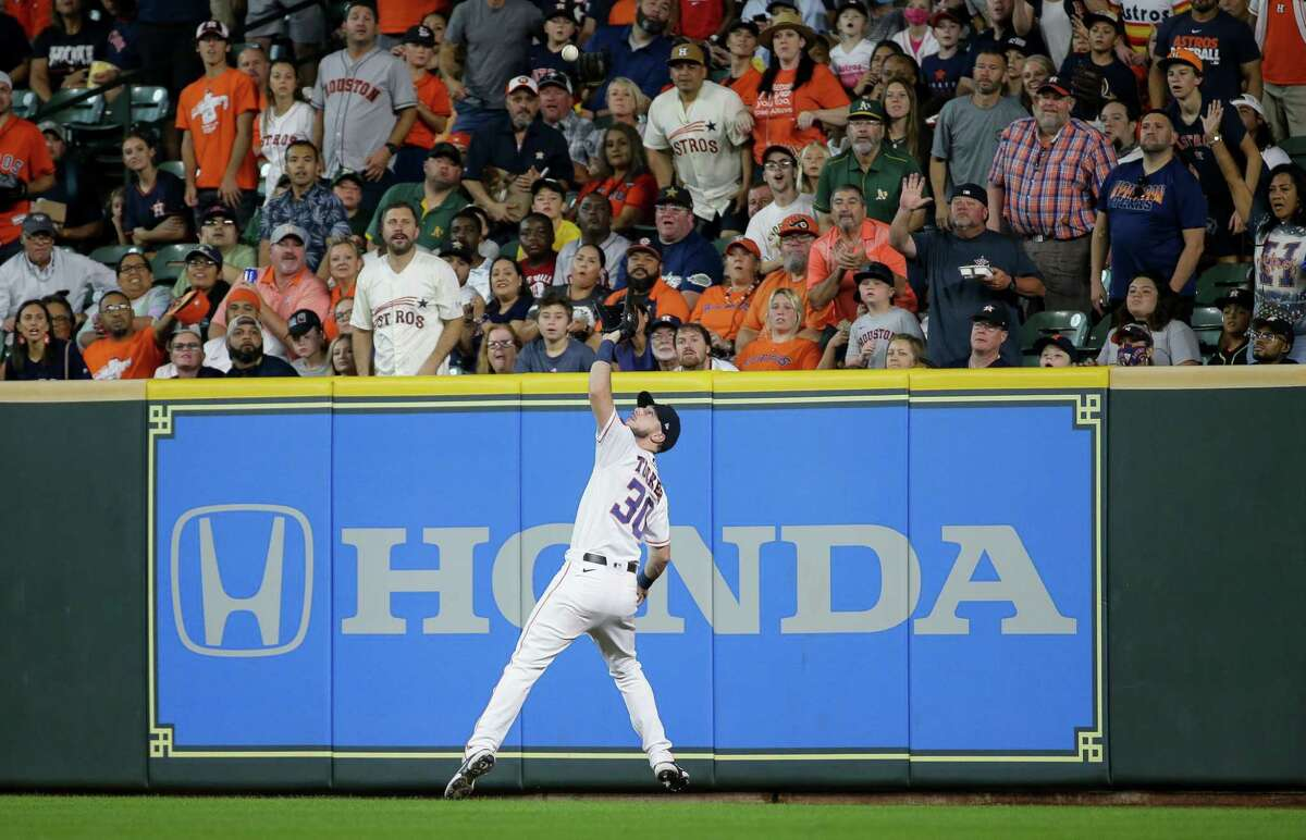 Houston Astros right fielder Kyle Tucker (30) catches the ball for an out against the Oakland Athletics during the second inning of an MLB game at Minute Maid Park on Thursday, July 8, 2021, in Houston.