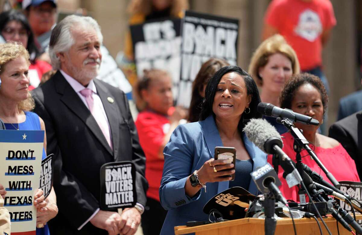 Rep. Nicole Collier, D-Fort Worth, stands with other Democratic caucus members as she speaks at a rally on the steps of the Texas Capitol to support voting rights, Thursday, July 8, 2021, in Austin, Texas. (AP Photo/Eric Gay)