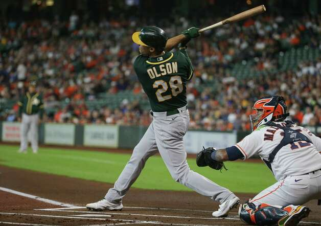 Oakland Athletics first baseman Matt Olson (28) hits an RBI ground-rule double to left field against the Houston Astros  during the first inning of an MLB game at Minute Maid Park on Thursday, July 8, 2021, in Houston. Photo: Godofredo A. Vásquez, Staff Photographer / © 2021 Houston Chronicle