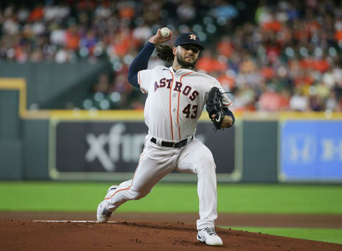 Houston Astros starting pitcher Lance McCullers Jr. (43) throws the ball against the Oakland Athletics during the first inning of an MLB game at Minute Maid Park on Thursday, July 8, 2021, in Houston.