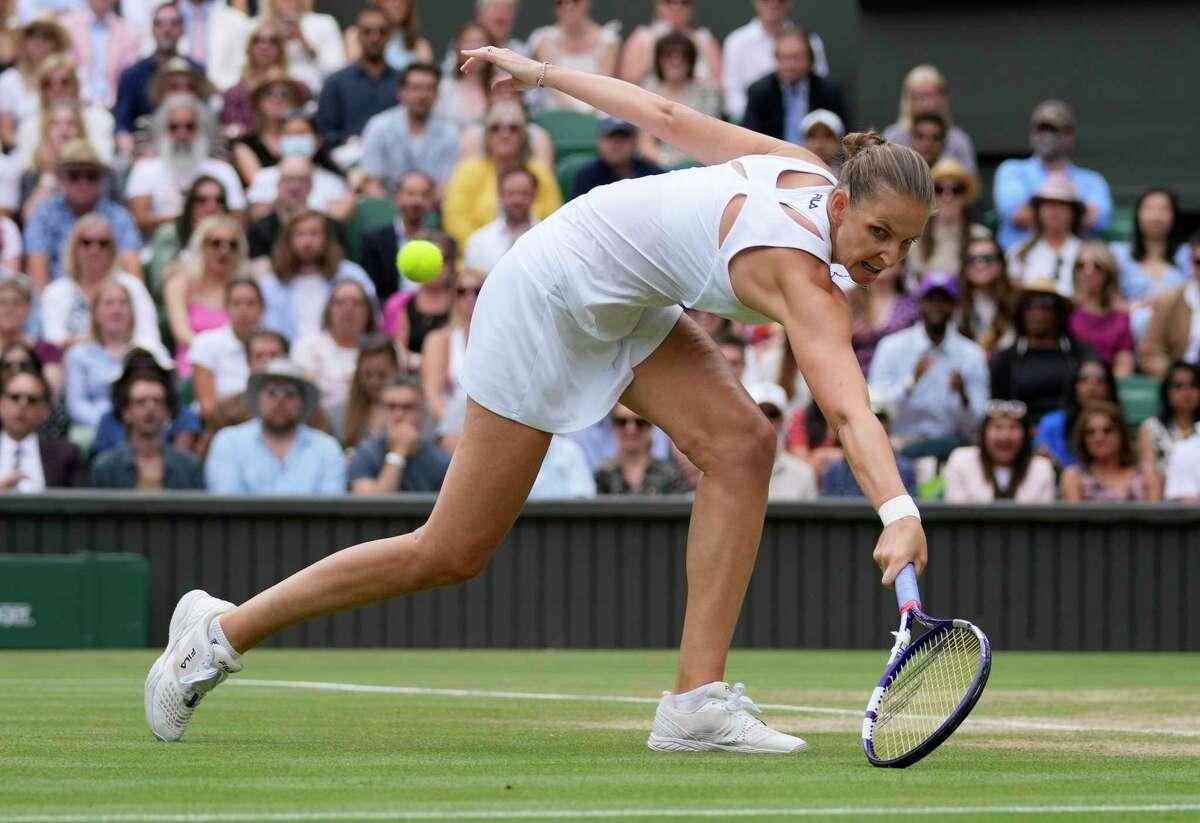 Czech Republic's Karolina Pliskova plays a return to Aryna Sabalenka of Belarus during the women's singles semifinals match on day ten of the Wimbledon Tennis Championships in London, Thursday, July 8, 2021. (AP Photo/Kirsty Wigglesworth)