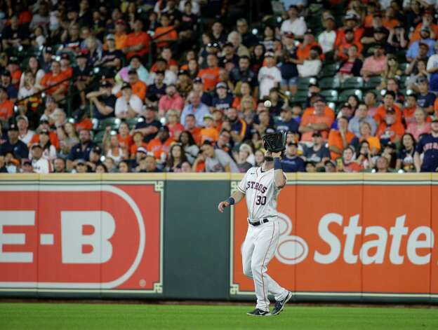 Houston Astros right fielder Kyle Tucker (30) makes a coach for an out against the Oakland Athletics during the third inning of an MLB game at Minute Maid Park on Thursday, July 8, 2021, in Houston. Photo: Godofredo A. Vásquez, Staff Photographer / © 2021 Houston Chronicle