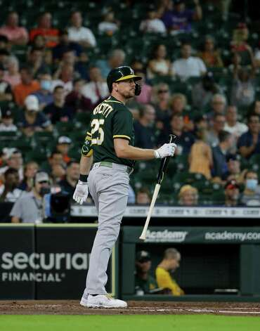 Oakland Athletics right fielder Stephen Piscotty (25) walks to the dugout after striking out against the Houston Astros during the third inning of an MLB game at Minute Maid Park on Thursday, July 8, 2021, in Houston. Photo: Godofredo A. Vásquez, Staff Photographer / © 2021 Houston Chronicle