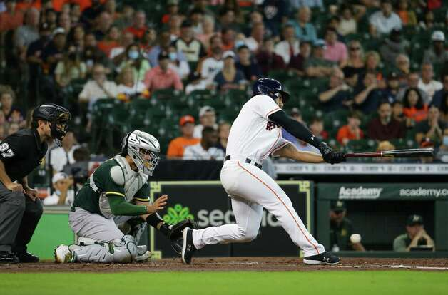 Houston Astros third baseman Abraham Toro (13) strikes out against the Oakland Athletics during the second inning of an MLB game at Minute Maid Park on Thursday, July 8, 2021, in Houston. Photo: Godofredo A. Vásquez, Staff Photographer / © 2021 Houston Chronicle