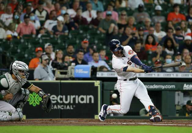 Houston Astros center fielder Chas McCormick (20) strikes out against the Oakland Athletics during the second inning of an MLB game at Minute Maid Park on Thursday, July 8, 2021, in Houston. Photo: Godofredo A. Vásquez, Staff Photographer / © 2021 Houston Chronicle