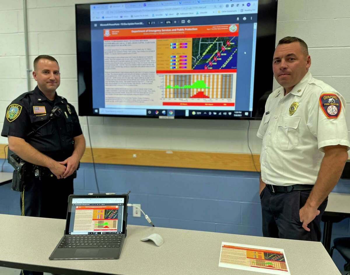 Guilford Deputy Chief Christopher Massey, left, and Assistant Chief / Deputy Fire Marshal Michael Stove tracked storm Elsa Thursday at the emergency management operations center.