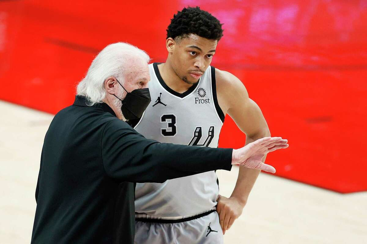 Spurs coach Gregg Popovich thinks the experience with the Select Team will help Keldon Johnson, right, improve and reach his offseason goals.