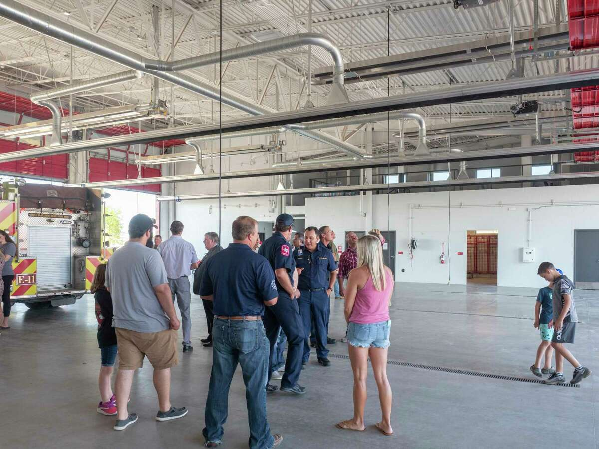 Midland residents, firefighters and family members tour the newly open Station 11 07/08/2021 off Briarwood Ave., across from Coyote Trail. Tim Fischer/Reporter-Telegram