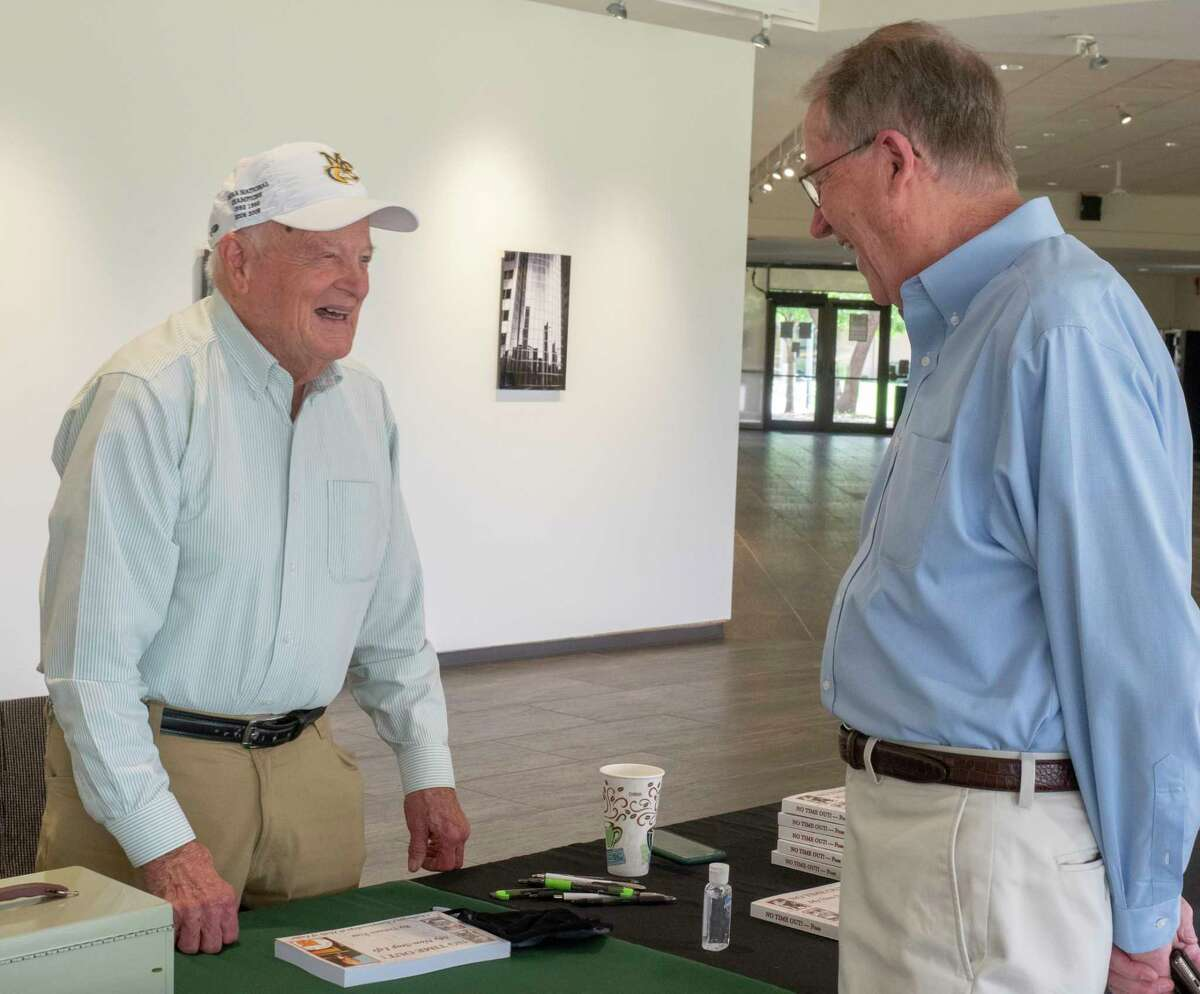 """Delnor Poss talks with longtime friend and former Midland College colleague Stan Jacobs as Midland College coach Delnor Poss was in town to sign copies of his book, """"No Time Out! My Non-stop Life"""" 07/08/2021 at Midland College Allison Fine Arts Building. Tim Fischer/Reporter-Telegram"""