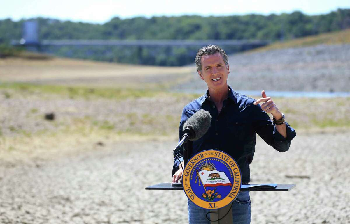 FILE - In this April 21, 2021, file photo California Gov. Gavin Newsom speaks at a news conference in the parched basin of Lake Mendocino in Ukiah, Calif., where he announced he would proclaim a drought emergency for Mendocino and Sonoma counties.