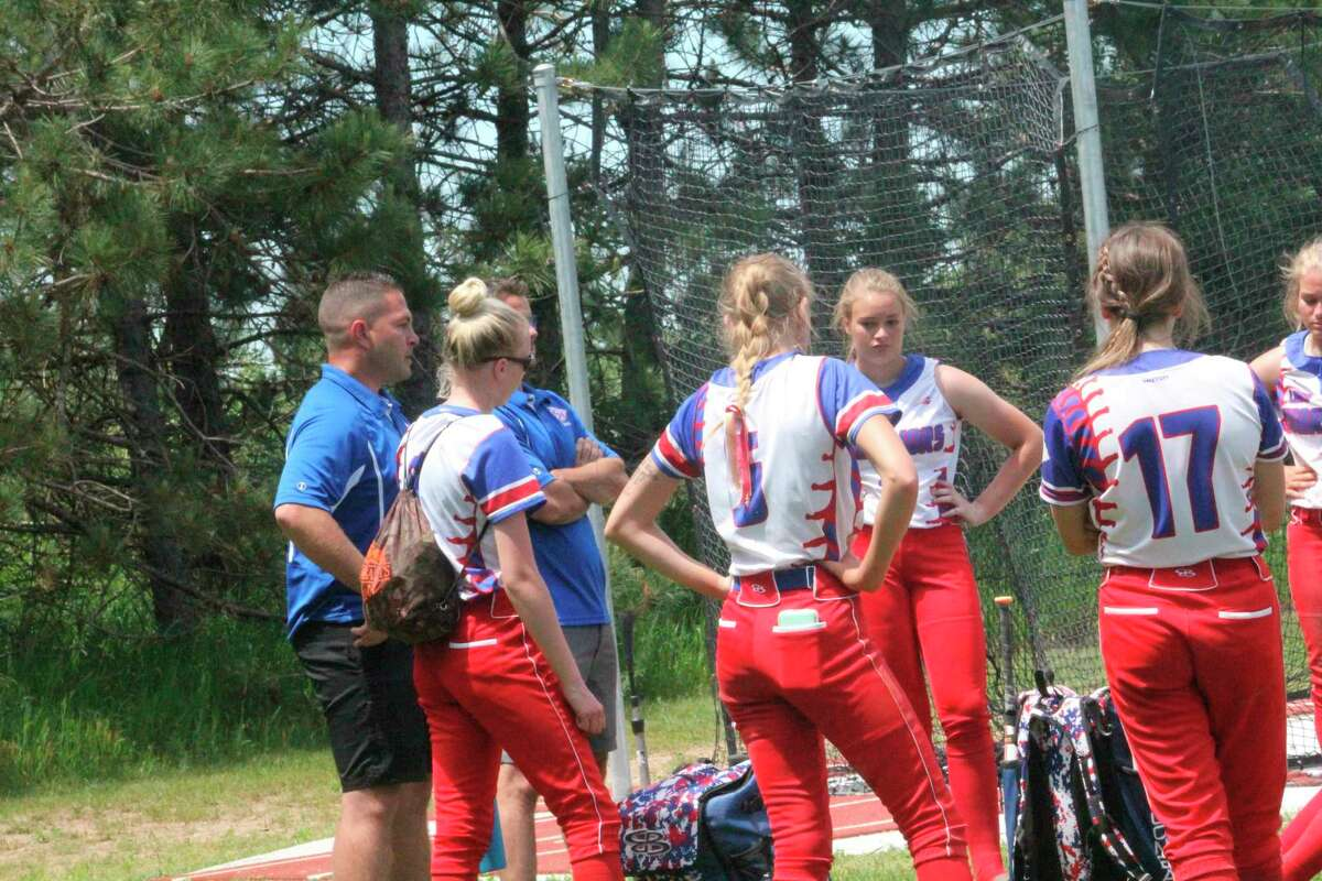 Chippewa Hills softball coach DJ Newman (left) talks to his team after the final game of the season. (Pioneer file photo)