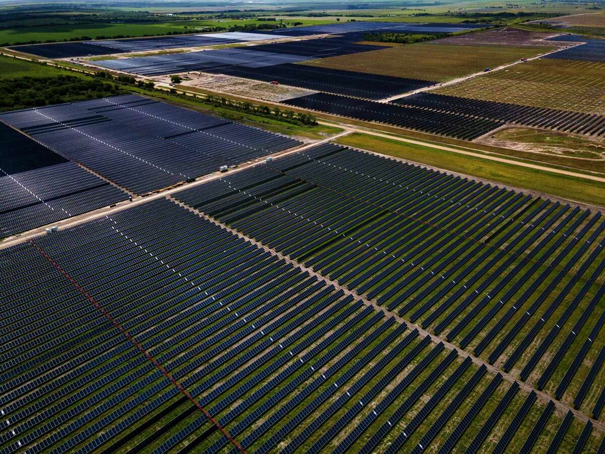 Solar panels fill fields, Tuesday, May 11, 2021, at a large solar farm south of El Campo.
