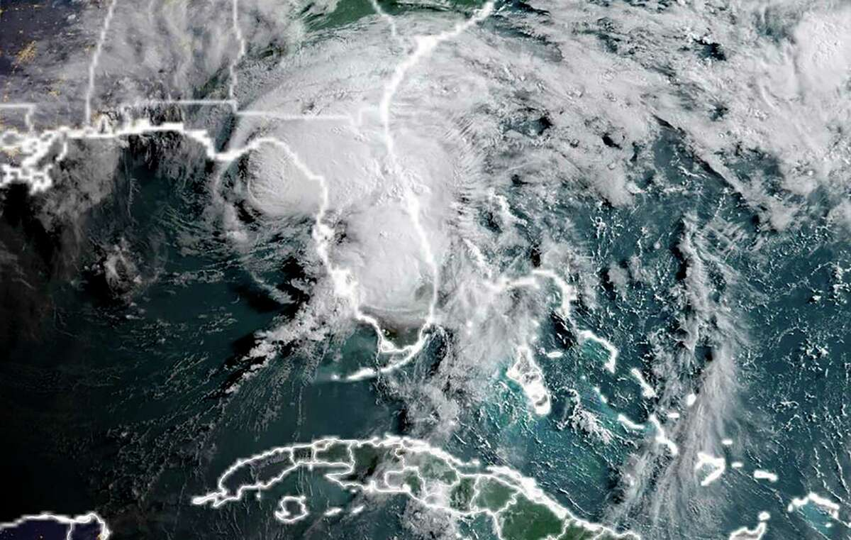 """This National Oceanic and Atmospheric Administration (NOAA) satellite image taken at 11:50 UTC on July 7, 2021 shows Tropical Storm Elsa located about 70 miles (115 kilometers) northwest of Tampa, Florida with maximum sustained winds near 65 mph (100 km/h), the NHC said in a public advisory at 5 am. - As it moved toward Florida's Gulf Coast early July 7, 2021, Elsa weakened to a tropical storm, though it still barreled inland with gusty winds and heavy rains, the US National Hurricane Center said. While some fluctuations in intensity remain possible until landfall later Wednesday morning, the hurricane warning for much of the state's west coast has been replaced with a tropical storm warning, the NHC said. (Photo by Handout / NASA/NOAA / AFP) / RESTRICTED TO EDITORIAL USE - MANDATORY CREDIT """"AFP PHOTO / NOAA/CIRA/RAMMB / HANDOUT """" - NO MARKETING - NO ADVERTISING CAMPAIGNS - DISTRIBUTED AS A SERVICE TO CLIENTS (Photo by HANDOUT/NASA/NOAA/AFP via Getty Images)"""