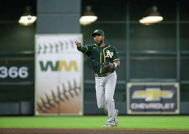 Oakland Athletics shortstop Elvis Andrus (17) throws to first base for an out against the Houston Astros during the sixth inning of an MLB game at Minute Maid Park on Thursday, July 8, 2021, in Houston. Photo: Godofredo A. Vásquez, Staff Photographer / © 2021 Houston Chronicle