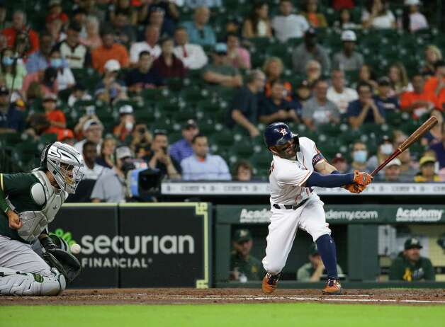 Houston Astros second baseman Jose Altuve (27) strikes out against the Oakland Athletics during the third inning of an MLB game at Minute Maid Park on Thursday, July 8, 2021, in Houston. Photo: Godofredo A. Vásquez, Staff Photographer / © 2021 Houston Chronicle