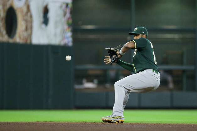 Oakland Athletics shortstop Elvis Andrus (17) fields a ground out against the Houston Astros during the sixth inning of an MLB game at Minute Maid Park on Thursday, July 8, 2021, in Houston. Photo: Godofredo A. Vásquez, Staff Photographer / © 2021 Houston Chronicle