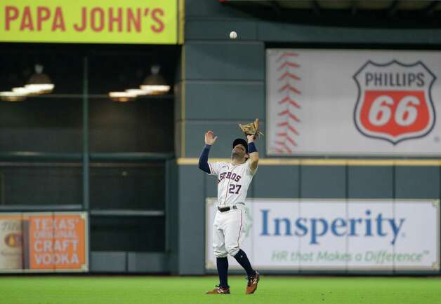 Houston Astros second baseman Jose Altuve (27) makes an out against the Oakland Athletics during the fifth inning of an MLB game at Minute Maid Park on Thursday, July 8, 2021, in Houston. Photo: Godofredo A. Vásquez, Staff Photographer / © 2021 Houston Chronicle