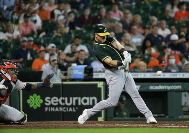 Oakland Athletics third baseman Matt Chapman (26) hits a single to center field against the Houston Astros during the fifth inning of an MLB game at Minute Maid Park on Thursday, July 8, 2021, in Houston. Photo: Godofredo A. Vásquez, Staff Photographer / © 2021 Houston Chronicle