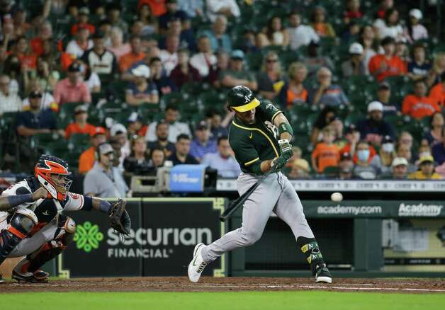 Oakland Athletics center fielder Ramon Laureano (22) hits a single against the Houston Astros during the fourth inning of an MLB game at Minute Maid Park on Thursday, July 8, 2021, in Houston. Photo: Godofredo A. Vásquez, Staff Photographer / © 2021 Houston Chronicle