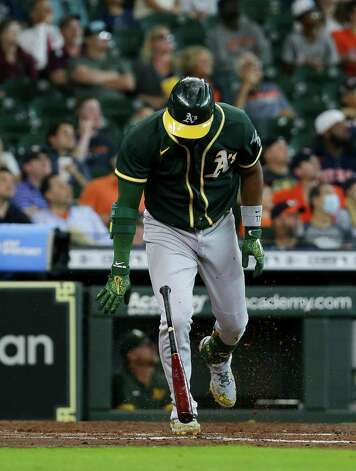 Oakland Athletics shortstop Elvis Andrus (17) slams his bat into the ground after hitting a fly out to left field against the Houston Astros during the fourth inning of an MLB game at Minute Maid Park on Thursday, July 8, 2021, in Houston. Photo: Godofredo A. Vásquez, Staff Photographer / © 2021 Houston Chronicle