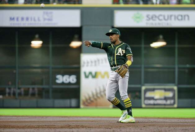 Oakland Athletics second baseman Tony Kemp (5) throws to first base for an out against the Houston Astros during the third inning of an MLB game at Minute Maid Park on Thursday, July 8, 2021, in Houston. Photo: Godofredo A. Vásquez, Staff Photographer / © 2021 Houston Chronicle