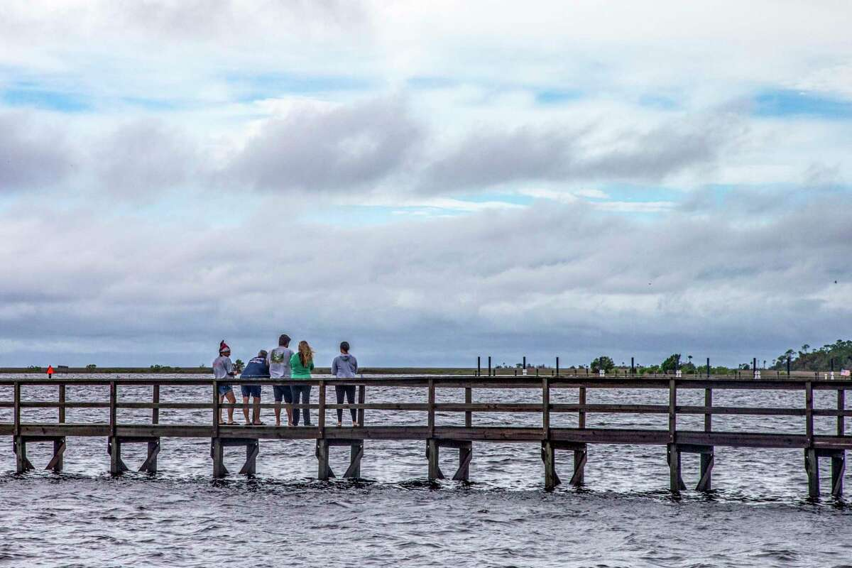 STEINHATCHEE, FL - JULY 07: Sightseers look at breaks in the clouds after Tropical Storm Elsa made landfall nearby on July 7, 2021 in Steinhatchee, Florida. Storm warnings remain in effect for parts of Florida's west coast as Tropical Storm Elsa made landfall on Wednesday morning. After hitting Cuba on Monday, causing flooding and mudslides, Elsa is expected to bring strong winds and rain as it heads north in the coming days. (Photo by Mark Wallheiser/Getty Images)