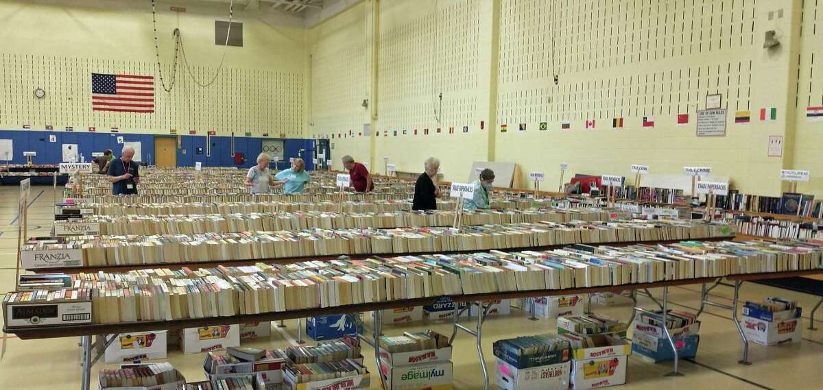 One of the two gymnasium-sized rooms full of books, CDs, DVDs, LPs, puzzles and games at the annual Friends of the C. H. Booth Library book sale at Reed Intermediate School in Newtown.