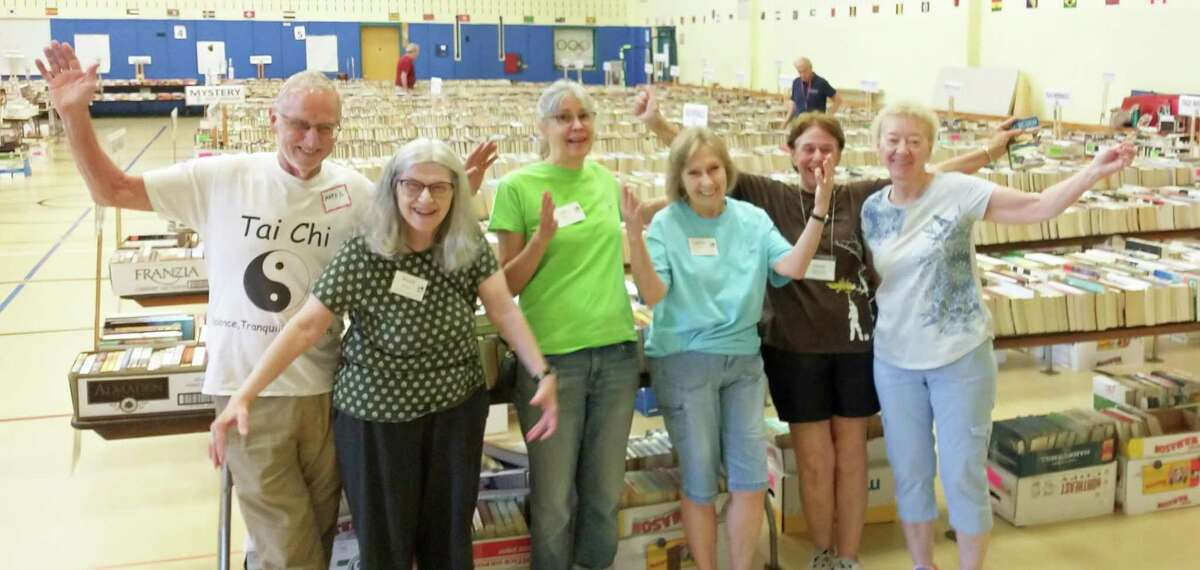 Volunteers Mark Aldrich, Wendy Wipprecht, Jane Gatenby, Cathy Maypen, Eleanor Zolov, and Claudia Dapp at the Friends of the C. H. Booth Library book sale at Reed Intermediate School in Newtown.