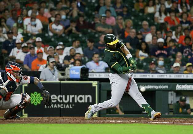 Oakland Athletics shortstop Elvis Andrus (17) hits a single to center field against the Houston Astros during the seventh inning of an MLB game at Minute Maid Park on Thursday, July 8, 2021, in Houston. Photo: Godofredo A. Vásquez, Staff Photographer / © 2021 Houston Chronicle