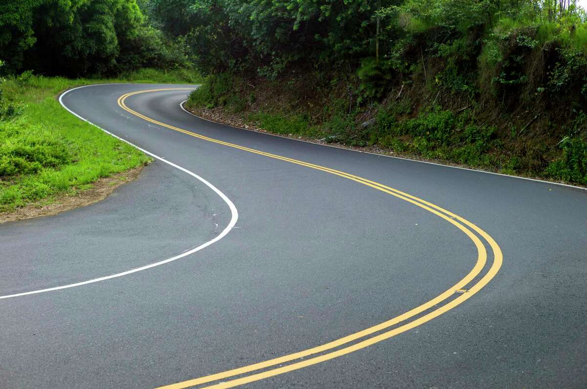 FILE- In this Sept. 24, 2014, file photo, is the curvy Hana Highway in Hana, Hawaii.