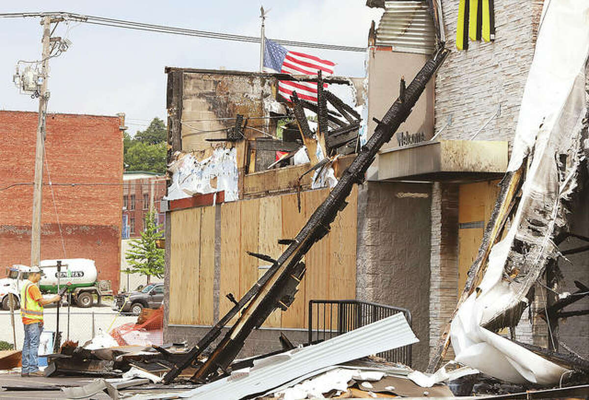 The McDonald's restaurant at 717 E. Broadway in Alton, destroyed in a June 17 fire, was showing signs of rebuilding plans Thursday. An employee of Farnsworth Group - a national engineering and architecture firm with 12 locations in Illinois alone - was collecting survery data at what is left of the building. The day of the fire owner Dick Bold vowed to rebuild the restaurant at the same location. The survey data would be one of the first steps in that process.
