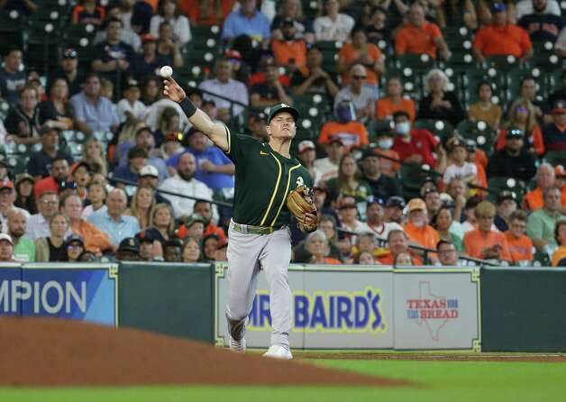 Oakland Athletics third baseman Matt Chapman (26) throws to first base for an out against the Houston Astros during the seventh inning of an MLB game at Minute Maid Park on Thursday, July 8, 2021, in Houston. Photo: Godofredo A. Vásquez, Staff Photographer / © 2021 Houston Chronicle