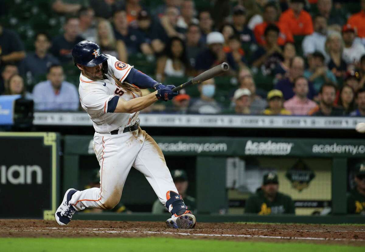 Houston Astros center fielder Chas McCormick (20) hits an RBI double to left field against the Oakland Athletics during the seventh inning of an MLB game at Minute Maid Park on Thursday, July 8, 2021, in Houston.