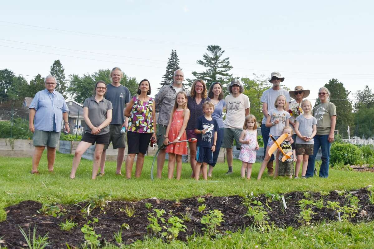 A group of volunteers stands in front of a portion of the new pollinator garden planted at the end of June at Sophia Street Community Garden near the corner of Michael and Sophia streets. The group planted all native perennials like spiderwort, wild strawberries, sedges, mountain mint, butterflyweed and columbines.