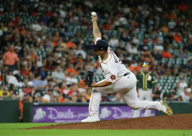 Houston Astros relief pitcher Andre Scrubb (70) throws the ball against the Oakland Athletics during the eighth inning of an MLB game at Minute Maid Park on Thursday, July 8, 2021, in Houston. Photo: Godofredo A. Vásquez, Staff Photographer / © 2021 Houston Chronicle