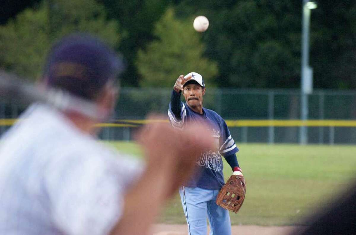 Robert Fisher tosses a pitch as the Board of Representatives battle the Mayor's office in a softball game at Kosciusko Park Tuesday, September 14, 2010.
