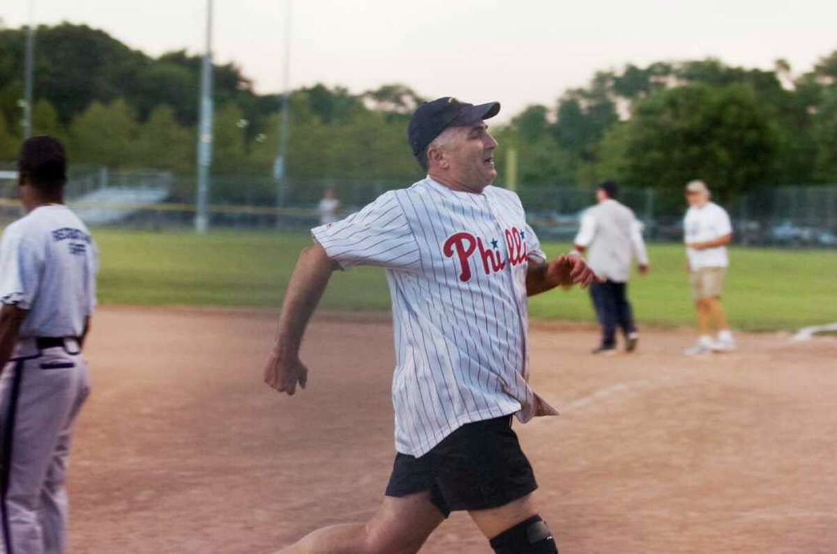 Scott Mirkin bring a run in for the Board of Representatives during a battle with the Mayor's office in a softball game at Kosciusko Park Tuesday, September 14, 2010.