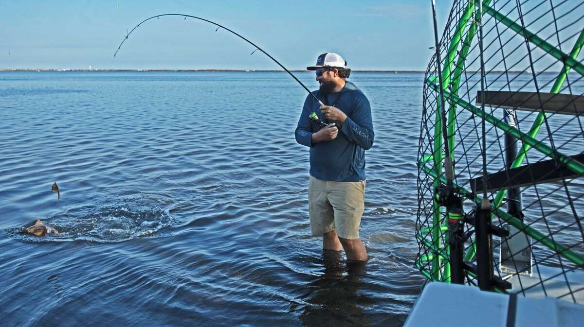 When a 26-inch redfish stripped line and got tangled up on the rear of the airboat, Capt. Jared McCulloch jumped into the 14-inch-deep water to get it loose.