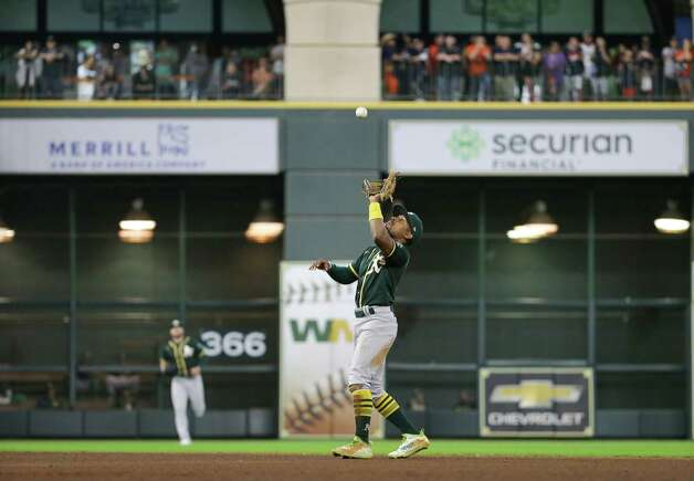 Oakland Athletics second baseman Tony Kemp (5) catches the ball for the final out of the eighth inning against the Houston Astros during an MLB game at Minute Maid Park on Thursday, July 8, 2021, in Houston. Photo: Godofredo A. Vásquez, Staff Photographer / © 2021 Houston Chronicle