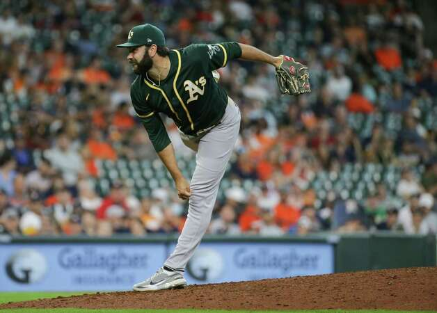 Oakland Athletics relief pitcher Lou Trivino (62) throws the ball against the Houston Astros during the eighth inning of an MLB game at Minute Maid Park on Thursday, July 8, 2021, in Houston. Photo: Godofredo A. Vásquez, Staff Photographer / © 2021 Houston Chronicle
