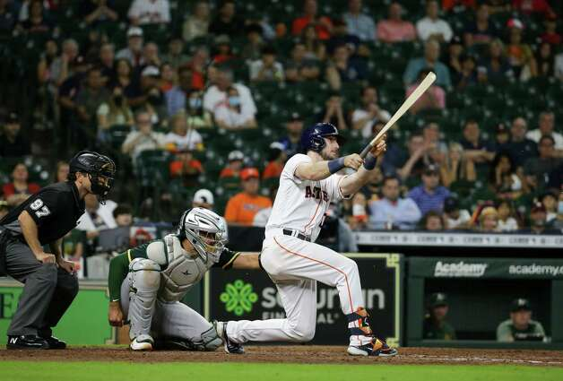Houston Astros right fielder Kyle Tucker (30) breaks his bat as he lined out to Oakland Athletics second baseman Tony Kemp (5) during the 9th inning of an MLB game at Minute Maid Park on Thursday, July 8, 2021, in Houston. Photo: Godofredo A. Vásquez, Staff Photographer / © 2021 Houston Chronicle
