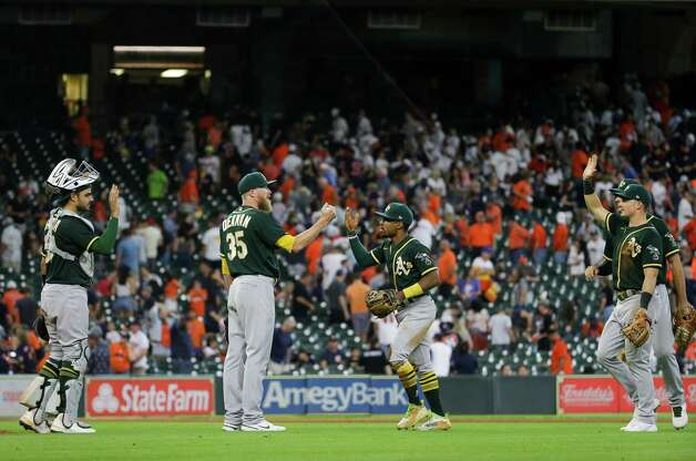 Oakland Athletics players celebrate after defeating the Houston Astros 2-1 at Minute Maid Park on Thursday, July 8, 2021, in Houston. Photo: Godofredo A. Vásquez, Staff Photographer / © 2021 Houston Chronicle