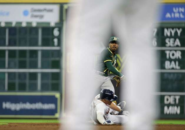 Oakland Athletics second baseman Tony Kemp (5) turns a double play against the Houston Astros during the 9th inning of an MLB game at Minute Maid Park on Thursday, July 8, 2021, in Houston. Photo: Godofredo A. Vásquez, Staff Photographer / © 2021 Houston Chronicle