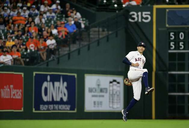 Houston Astros shortstop Carlos Correa (1) throws a ball to first base for an out against the Oakland Athletics during the 9th inning of an MLB game at Minute Maid Park on Thursday, July 8, 2021, in Houston. Photo: Godofredo A. Vásquez, Staff Photographer / © 2021 Houston Chronicle