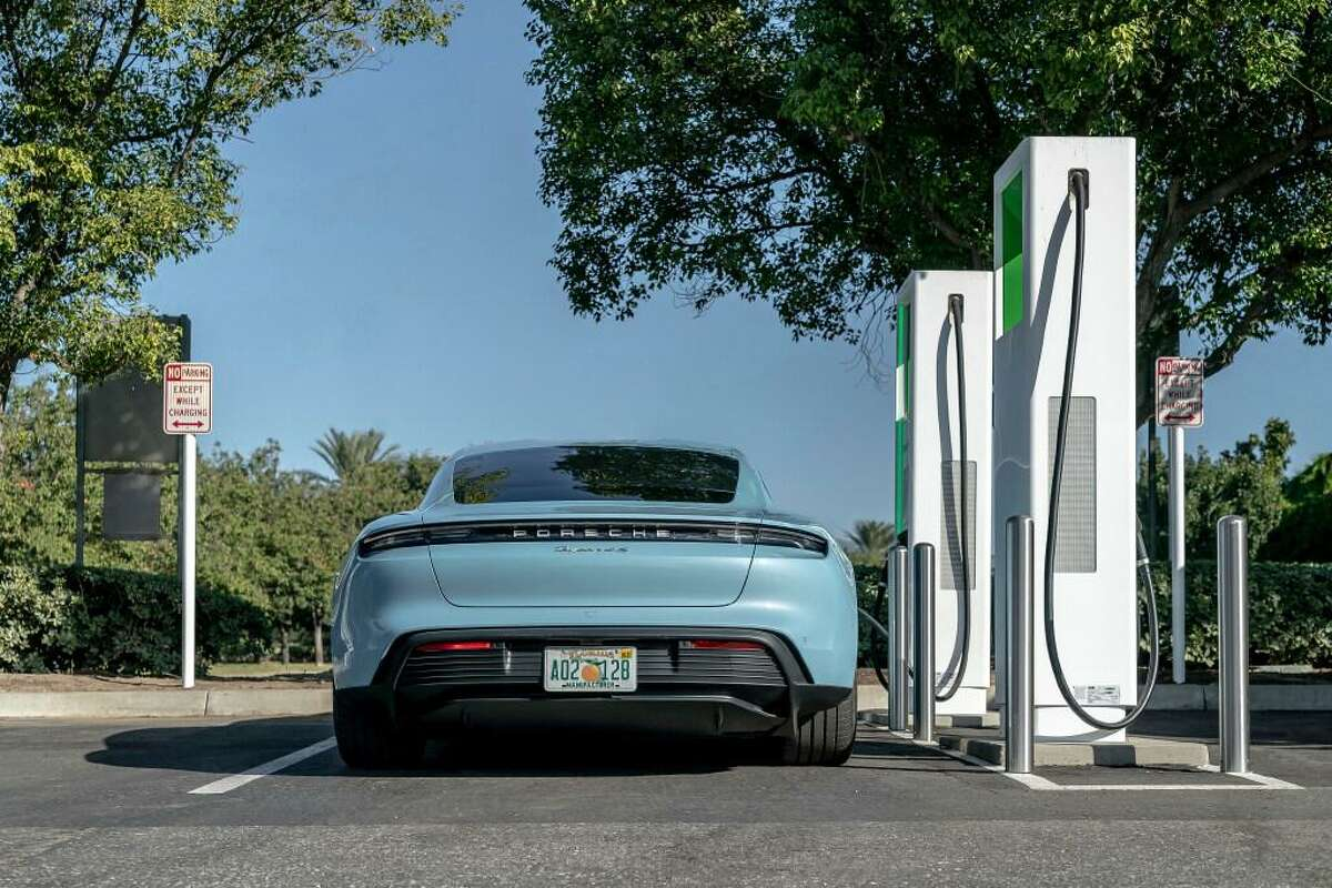 This photo provided by Porsche shows its first all-electric production car, the 2020 Taycan, charging up at a public charging station. Its official range according to the EPA is 203 miles on a single charge, but in Edmunds' testing the Taycan showed it's capable of going over 100 additional miles.